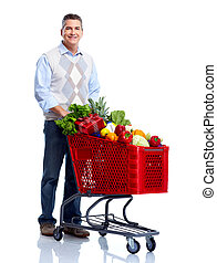 Man with a shopping cart. Grocery.