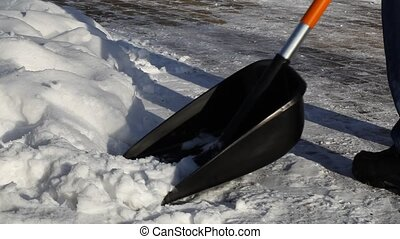 Man with a snow shovel on the sidewalk episode 1