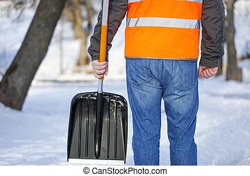 Man with a snow shovel