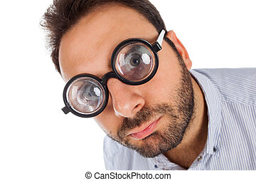 Man with a surprised expression and thick glasses - Young...