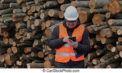 Man with a tablet PC  numbering