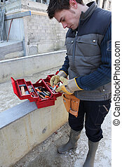 Man with a toolbox