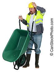 Man with a wheelbarrow having an accident