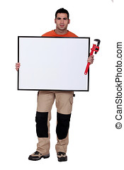 Man with a wrench and a board left blank for your message