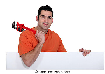 Man with a wrench and board left blank for your message