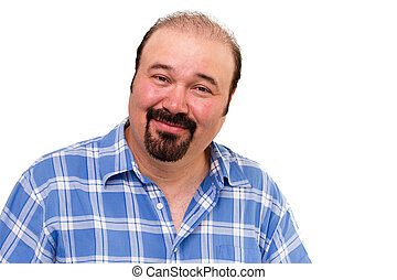 Overweight man with a goatee beard looking at the camera with an amused kindly expression isolated on white