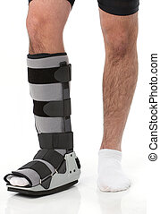 Man with an ankle brace over white