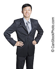 young asian businessman in neat suit with arms akimbo, isolated white background