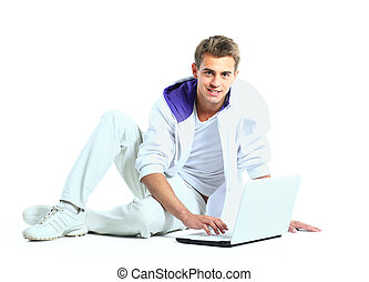 Man with arms raised using laptop