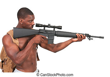 Man with Assault Rifle - Handsome man holding an automatic...