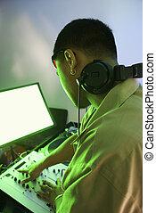 Man with audio equipment.