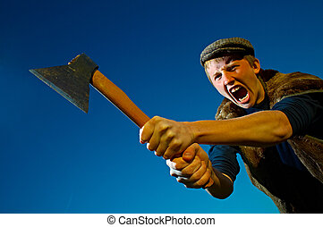 man with axe - cruel man with axe on background blue sky