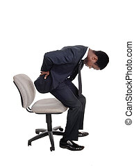 Man with back pain getting up from chair - A young business...