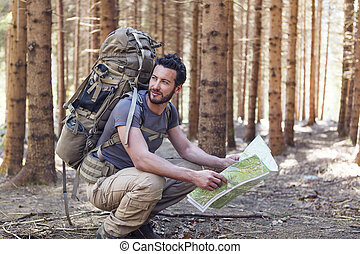 Man with Backpack and map searching directions - Beard Man...
