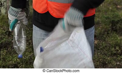 Man with bag of plastic bottles
