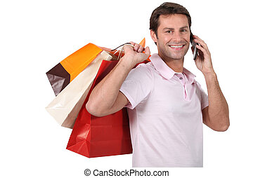 Man with bag on the phone