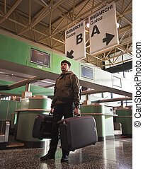 Man with baggage at the airport