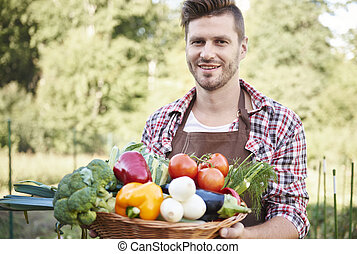 Man with basket full of vegetables