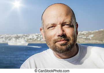 An image of a handsome middle age man with a beard