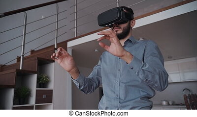 Man with beard and 3d virtual glasses is standing by 360...