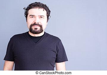 Man with Beard and Curly Hair Wearing Dark T-Shirt