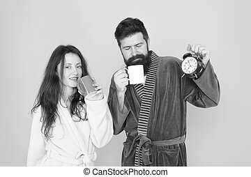 man with beard and sleepy woman enjoy morning coffee or tea time to wake up and have nice day guy stock photography csp74131206