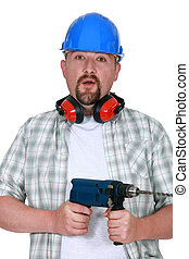 Man with beard holding power drill