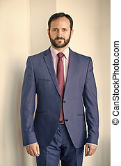 Man with beard in blue formal suit