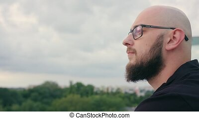 Man with Beard Looks into the Distance - A man with a beard...