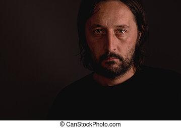 Man with beard, low key portrait