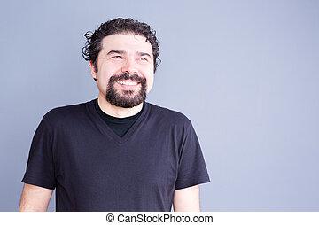 Man with Beard Smiling Joyfully in Studio