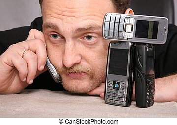 man with beard speaks on the cell phone, relying on the...