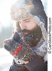 Man with beard warming up