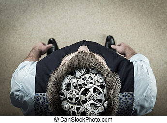 Man with bearing in his brain - Up view of man withmechanism...