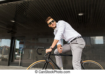 man with bicycle and headphones on city street - lifestyle,...