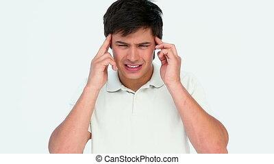 Man with big headache against white background