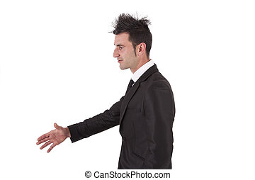man with black suit shaking hands