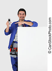 Man with blank board, toolbelt and cellphone