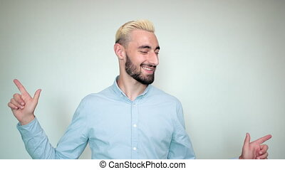 man with blond hair, black beard over isolated white background shows emotions