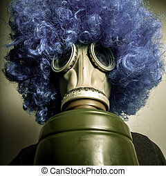 man with blue wig and gas mask