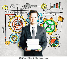 Man with books and business diagram drawn on concrete wall