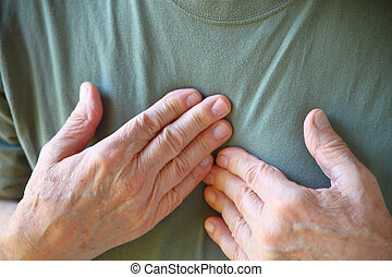 Man with both hands on chest