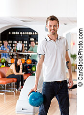 Man With Bowling Ball in Club