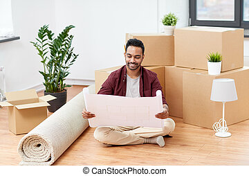 man with boxes and blueprint moving to new home