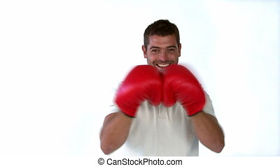 Man with boxing gloves in front of the camera