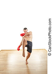 man with boxing gloves ready to kick opponents