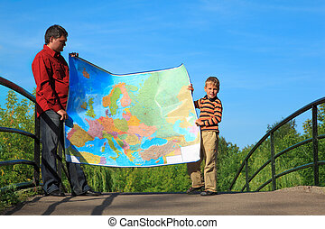 man with  boy they hold in hands  expanded map outdoor