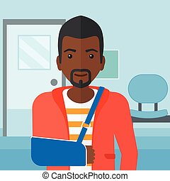 Man with broken arm. - An african-american man with broken ...