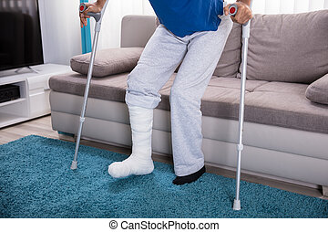 Man With Broken Leg Walking On Carpet