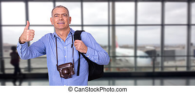 man with camera and luggage at the airport